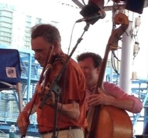 Russell George at the Jacksonville Jazz Festival, May 25, 2014. At age 70, after a lifetime as a successful bass musician, he took up violin. And boy, did he take up violin! Twelve years now, a wondrous twist to life!