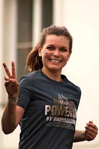 woman running wearing gray shirt